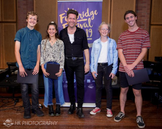 2019 Quest winners: Isaac Smalley, Sofia Hourani, Tex Holmes and Jye Criddle with Patron, Kav Temperley (centre)
